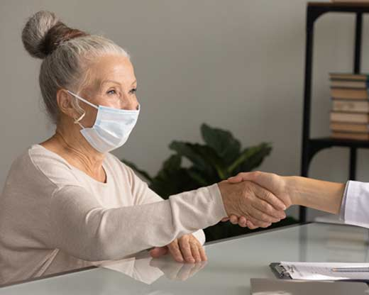 Old lady with a face mask