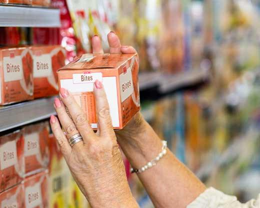 Senior woman buying food